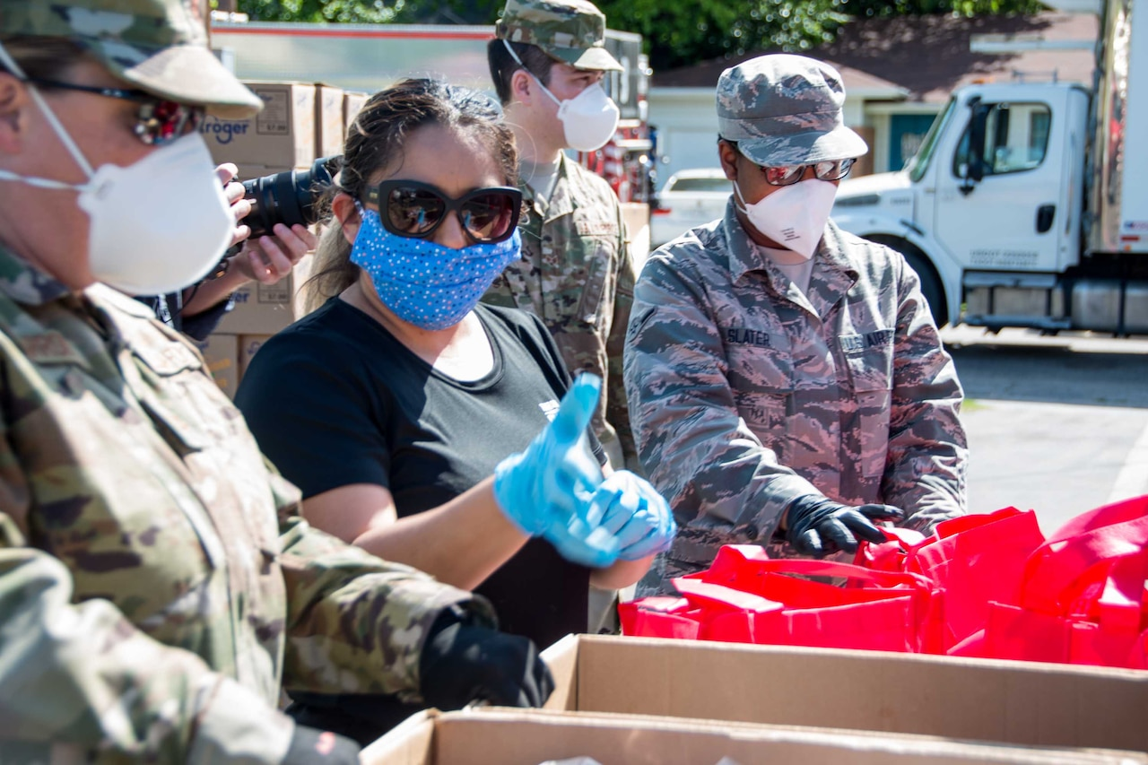 Texas Air National Guard airmen helping at a food bank.