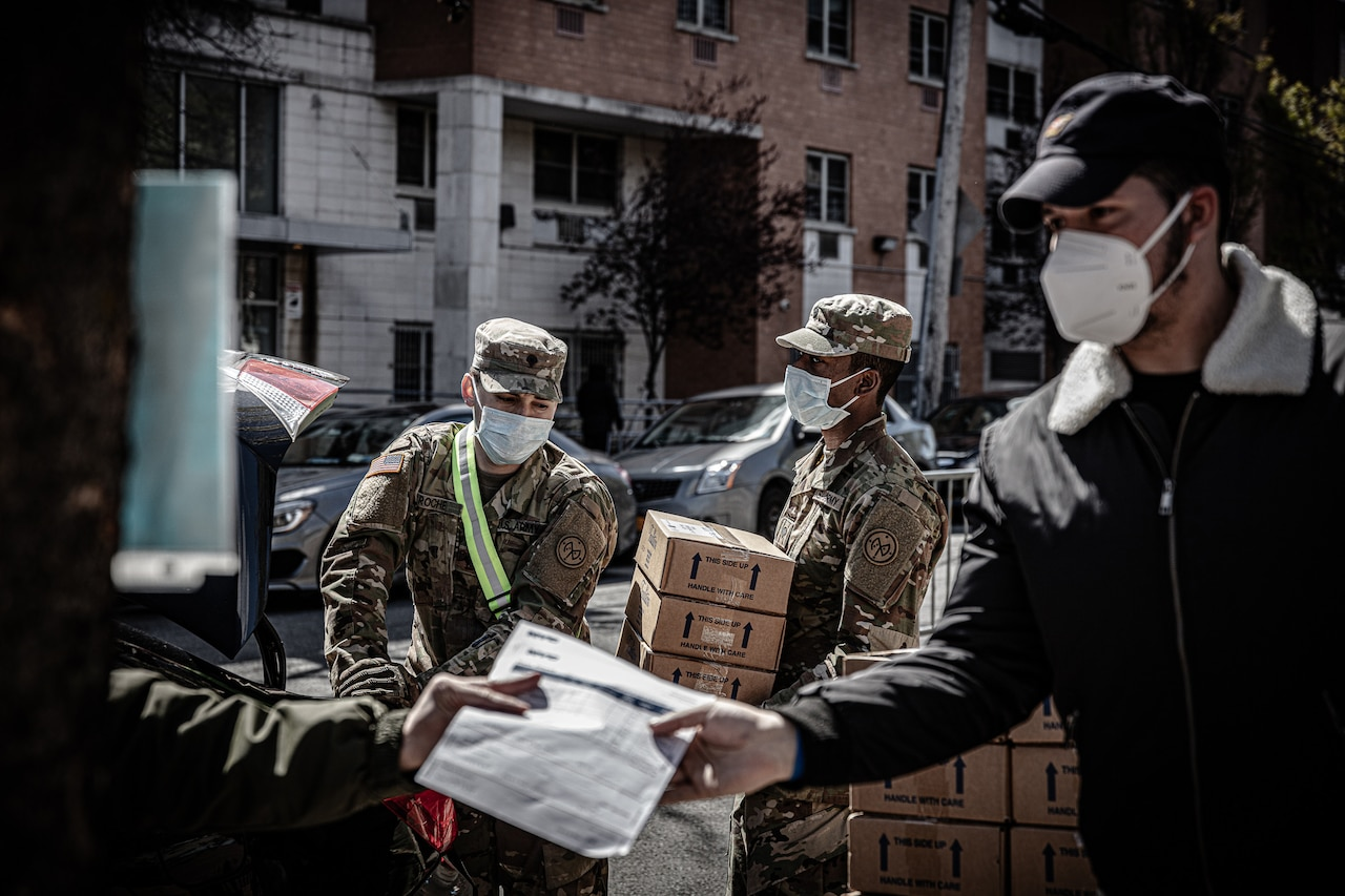 National Guardsmen distributing food.