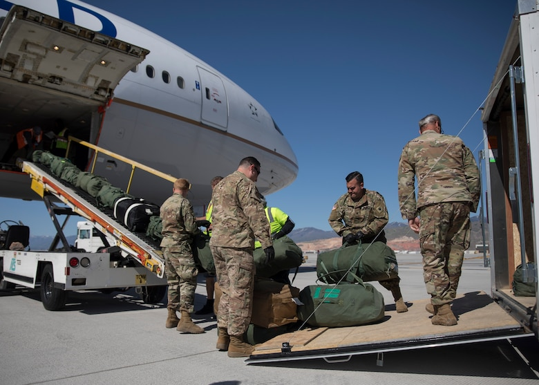 Soldiers assigned to the Utah National Guard's 1st Batallion, 211th Aviation Regiment, depart Roland R. Wright Air National Guard Base in Salt Lake City, Utah, May 7, 2020.