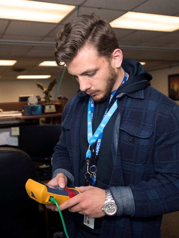 A photo of a commercial network administrator that goes with an EITaaS story.