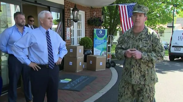 U.S. Navy Rear Admiral John Polowczyk, Federal Emergency Management Agency Supply Chain Task Force Lead speaks to the media as Vice President Michael Pence looks on in front Woodbine Rehabilitation & Healthcare Center, Alexandria, Va. where the first of $134 million worth of personal protective equipment kits were delivered May 7. The Defense Logistics Agency ordered the kits, which will be delivered to approximately 15,000 nursing homes throughout the U.S., to provide medical staff members with 14-days worth of protective eyewear, medical gowns, masks and nitrite gloves. The items were requested by the White House Coronavirus Task Force and funded by FEMA.