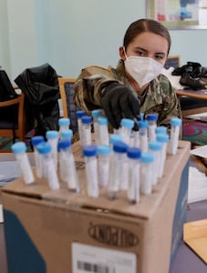 Georgia National Guard Spc. Illiana Bartsch of the Ft. Stewart-based 179th Military Police Company sorts test specimen vials at Delmar Gardens of Smyrna April 29, 2020. Bartsch is a member of a Georgia National Guard mobile testing strike team deployed to test senior citizens for COVID-19.