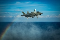 SOUTH CHINA SEA (April 18, 2020) An F-35B Lightning II fighter aircraft with Marine Medium Tiltrotor Squadron (VMM) 265 (Reinforced), 31st Marine Expeditionary Unit (MEU), prepares to land on the flight deck of amphibious assault ship USS America (LHA 6) during flight operations. Marines and Sailors aboard the America regularly conduct flight operations while underway to maintain their readiness to respond to contingencies. America, flagship of the America Expeditionary Strike Group, 31st MEU team, is operating in the U.S. 7th Fleet area of operations to enhance interoperability with allies and partners and serve as a ready response force to defend peace and stability in the Indo-Pacific region. (U.S. Marine Corps photo by Sgt. Audrey M. C. Rampton)
