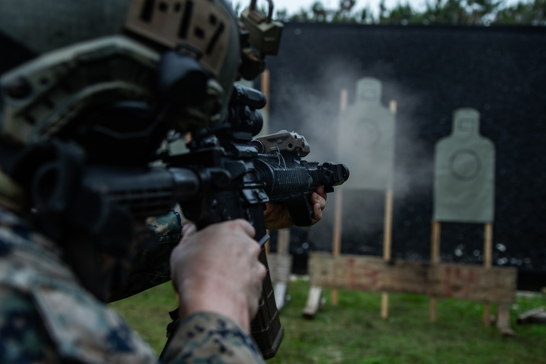 A U.S. Marine fires his M4A1 service rifle during a modified qualification as part of a close-quarters tactics range on Camp Hansen, Okinawa, May 11.
