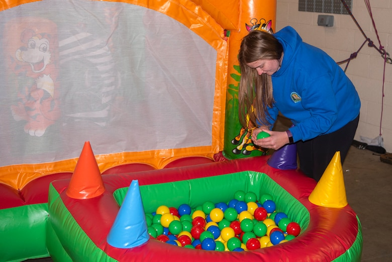 Kim Stonebridge, 100th Force Support Squadron outdoor recreation adventure programmer, inspects the condition of a newly  arrived bouncy castle, inside the outdoor recreation center at RAF Mildenhall, England, May 11, 2020. Although the center continues to rent out certain items like yard equipment, mountain bikes and outdoor games, items that facilitate gatherings of people are not available for rental during the COVID-19 lockdown. (U.S. Air Force photo by Airman 1st Class Joseph Barron)
