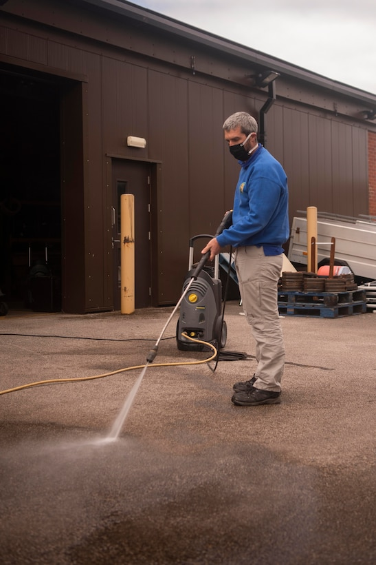 Keith Thomas, 100th Force Support Squadron Outdoor Recreation rental manager, tests the function of a pressure washer outside the outdoor recreation center at RAF Mildenhall, England, May 11, 2020. A variety of household tools and equipment are available to rent from the center for daily and weekly rates. (U.S. Air Force photo by Airman 1st Class Joseph Barron)
