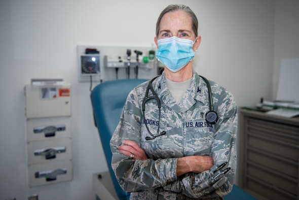 The 633rd Medical Operations Squadron family health flight commander, stands in an examination room.