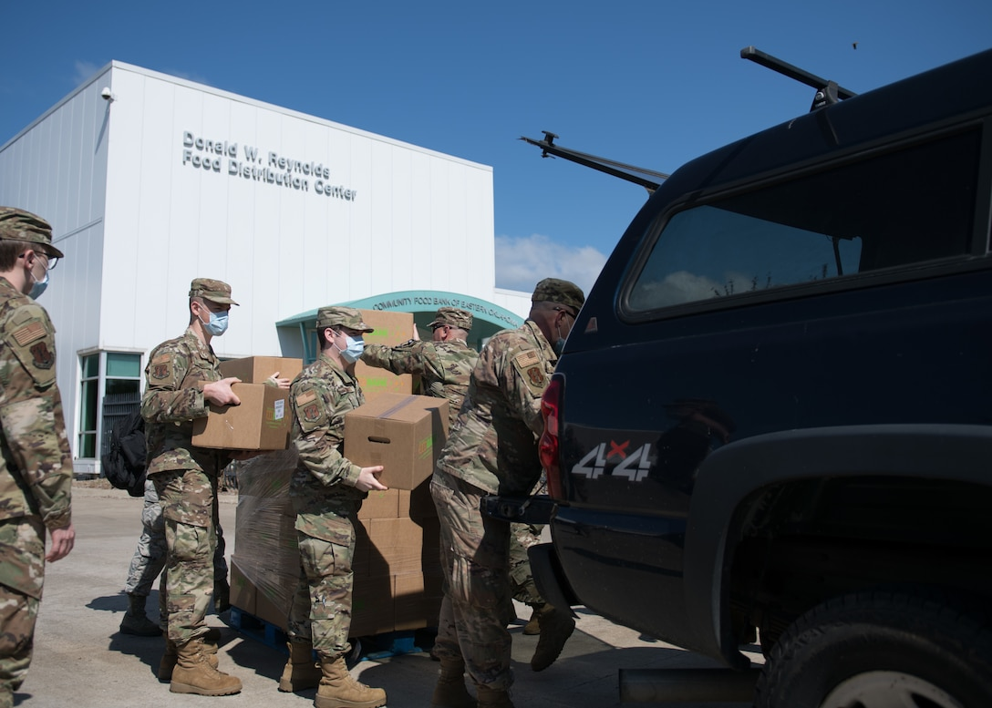 Airmen from the 138th Fighter Wing, Oklahoma Air National Guard, load boxes of food to be delivered at the Community Food Bank of Eastern Oklahoma in Tulsa, Oklahoma, April 23, 2020. Twenty five Airmen from the 138th FW are working with the food bank to provide support including receiving, packing and transporting food, as well as completing inventories of food bank supplies. At the direction and authorization of Oklahoma Governor Kevin Stitt, Oklahoma Guardsmen were activated to serve in various roles in support of the State's COVID-19 response (U.S. Air National Guard photo by Tech. Sgt. Rebecca Imwalle)