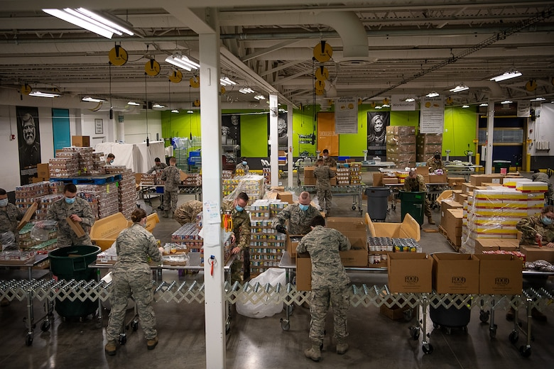 Oklahoma Air National Guardsmen from the 137th Special Operations Wing help to sort, box, palletize and prepare food for transport in support of the Regional Food Bank of Oklahoma in Oklahoma City, April 24, 2020. Oklahoma Gov. Kevin Stitt activated 25 additional Guardsmen in Oklahoma City and another 25 in Tulsa to assist the regional food banks with packing and shipping of food products. Food banks across the State have seen an increase of as much as 60 percent in the need for food assistance. The food bank is just one operation of the Oklahoma National Guard's overall mission in support of Oklahoma's whole-of-government response to COVID-19. (U.S. Air National Guard photo by Tech. Sgt. Kasey Phipps)