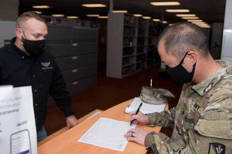 U.S. Army Staff Sgt. Nicolas Chang, 128th Aviation Brigade, Headquarters and Headquarters Company senior supply sergeant, signs for face mask for his unit at Joint Base Langley-Eustis, Virginia, May 13, 2020. Units that need face mask can file a request through the Central Issue Facility for the required amount. (U.S. Air Force photo by Senior Airman Derek Seifert)