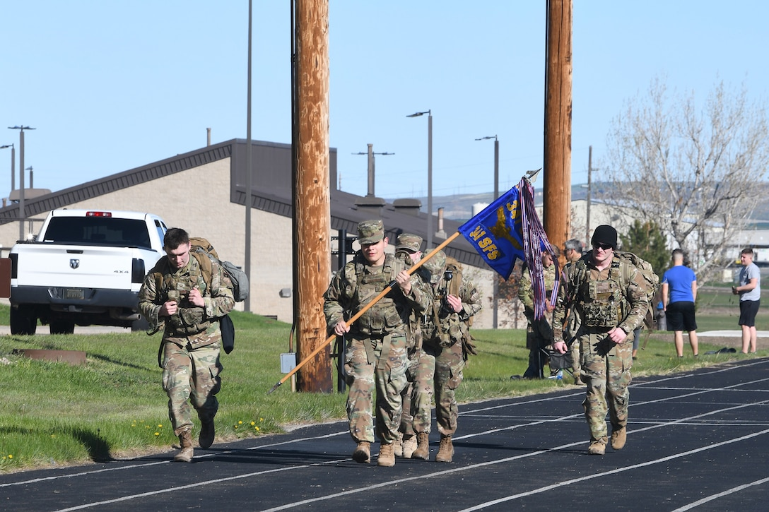 Airmen take part in a ruck march in honor of fallen defenders May 14, 2020, at Malmstrom Air Force Base, Mont.