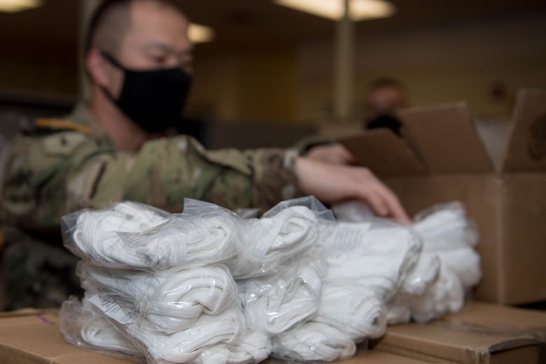 U.S. Army Staff Sgt. Nicolas Chang, 128th Aviation Brigade, Headquarters and Headquarters Company senior supply sergeant, counts face mask at Joint Base Langley-Eustis, Virginia, May 13, 2020. According to guidelines in combating COVID-19, face mask and social distancing is the best way to limit exposure to the virus. (U.S. Air Force photo by Senior Airman Derek Seifert)