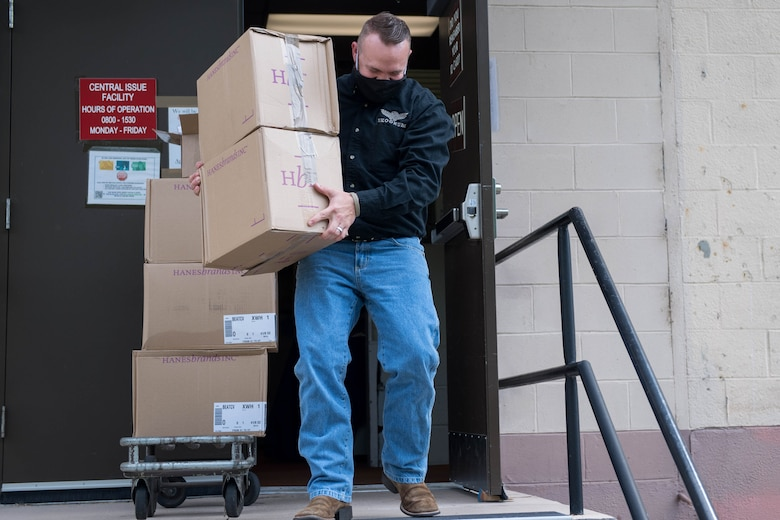 Josh Howe, Central Issue Facility supply technician, carries boxes of face mask at Joint Base Langley-Eustis, Virginia, May 13, 2020. A commercial vendor donated 7.5 million masks to the U.S. Army. (U.S. Air Force photo by Senior Airman Derek Seifert)
