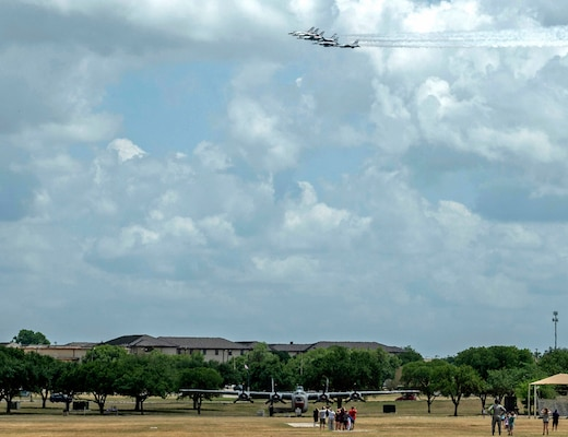 """The United States Air Force Air Demonstration Squadron """"Thunderbirds"""" perform a flyover at Joint Base San Antonio-Lackland during their America Strong salute May 13."""