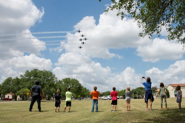 Children from the Joint Base San Antonio-Randolph School Age Program watch as the U.S. Air Force Air Demonstration Squadron, the Thunderbirds, fly over the Taj Mahal during their America Strong salute, at JBSA-Randolph May 13.
