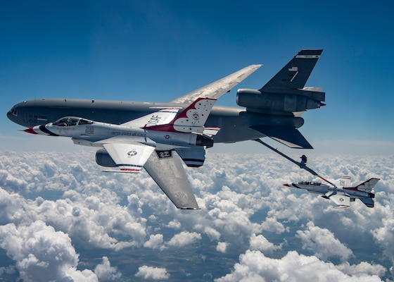 """The United States Air Force Air Demonstration Squadron """"Thunderbirds"""" receive fuel over Texas May 13 from the 60th Air Mobility from Travis Air Force Base, California."""