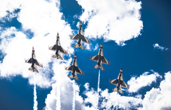 """The United States Air Force Air Demonstration Squadron """"Thunderbirds"""" fly over Joint Base San Antonio-Randolph during their America Strong salute May 13."""