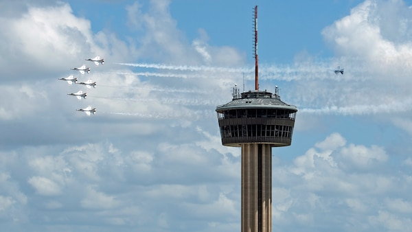 """The United States Air Force Air Demonstration Squadron """"Thunderbirds"""" fly in formation over San Antonio as part of Operation America Strong May 13."""