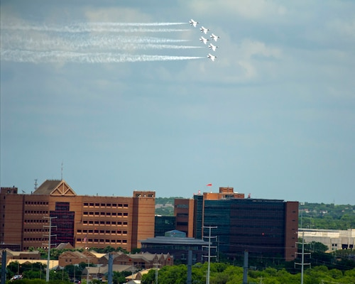 """The United States Air Force Air Demonstration Squadron """"Thunderbirds"""" fly over Brooke Army Medical Center at Joint Base San Antonio-Fort Sam Houston during their America Strong salute May 13."""