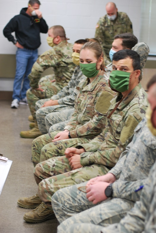 Pennsylvania National Guard members prepare to enter Brighton Rehab and Wellness Center in Beaver, Pennsylvania, May 10, 2020. About 40 Guard members are assisting with medical, administrative and cleaning services at the facility.