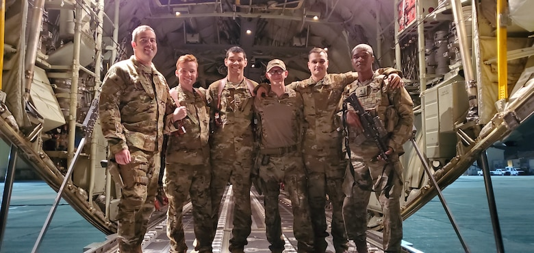 An aircrew assigned to the 774th Expeditionary Airlift Squadron poses for a group photo in Afghanistan, Sept. 2019.