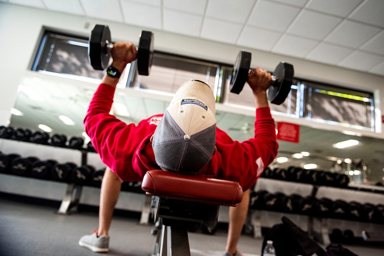 Photo of service member lifting weights.