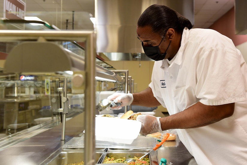 Nelson O'Neal, Guardian Dining Facility (DFAC) cook, prepares a to-go meal for a customer at Creech Air Force Base, Nevada, April 17, 2020.