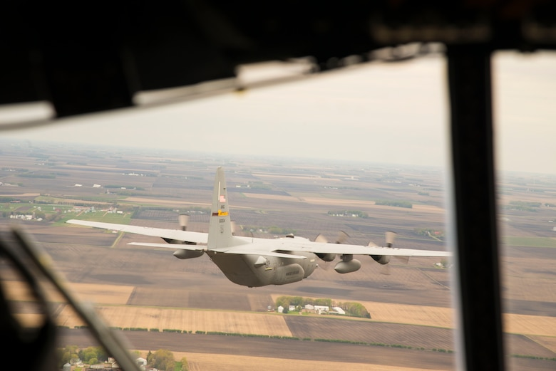 A U.S. Air Force C-130 from the 133rd Airlift Wing flies with a C-130 from the 934th Airlift Wing during a flyover in Minnesota, May 13, 2020. The 934th Airlift Wing along with the Minnesota National Guard's 133rd Airlift Wing flew statewide flyovers in recognition of those on the frontlines of the COVID-19 pandemic response as part of Operation American Resolve. (U.S. Air Force photo by Chris Farley)