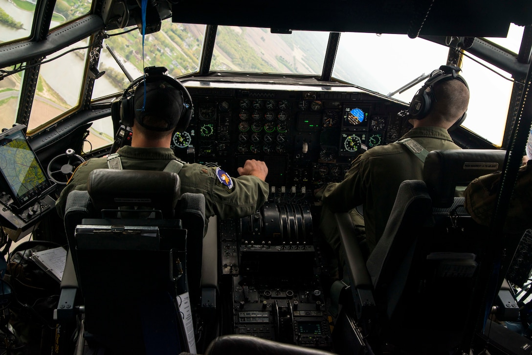 Maj. Ethan Bryant and Capt. Mike McFadden, both are pilots with the 96th Airlift Squadron, fly a U.S. Air Force C-130 during a flyover in Minnesota, May 13, 2020. The 934th Airlift Wing along with the Minnesota National Guard's 133rd Airlift Wing flew statewide flyovers in recognition of those on the frontlines of the COVID-19 pandemic response as part of Operation American Resolve. (U.S. Air Force photo by Chris Farley)