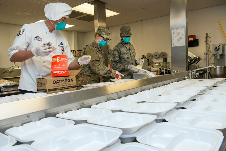 Airmen making boxed lunches