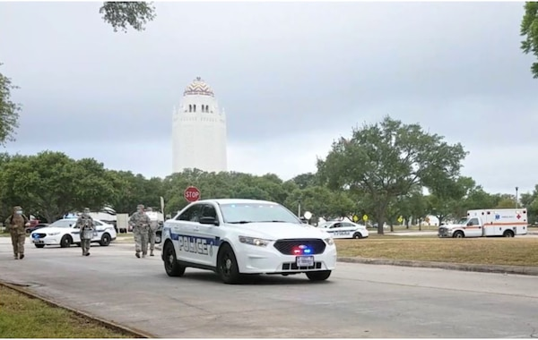 The lead vehicle of the procession during the National Police Week parade drives down C Street at Joint Base San Antonio-Randolph, Texas, May 13, 2020. Due to COVID-19 and social distancing, the 902nd Security Forces Squadron invited other first responders to join them in parading through base housing so the community could show their appreciation.