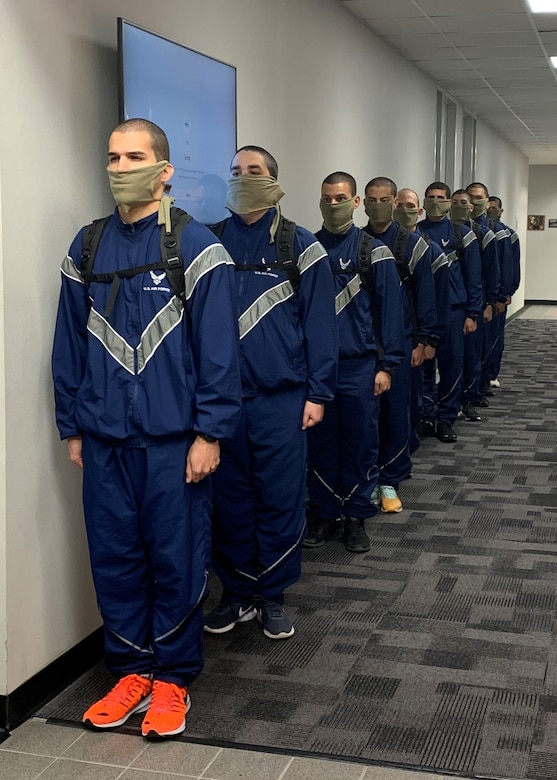 US Air Force Echo Flight trainees stand in line in the halls of DLIELC. They came to campus in person to take their placement English Comprehension Level placement exam. They will be attending their English learning classes via distance learning from the 737 TRSS learning lab.
