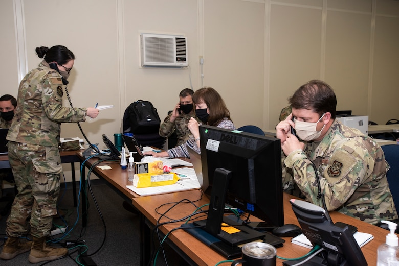 Members of the Reception Control Center coordinate Base Support Installation logistics requirements for forces temporarily assigned to Joint Base McGuire-Dix-Lakehurst, N.J., May 6, 2020. U.S. Northern Command, through U.S. Army North, remains committed to providing flexible Department of Defense support to the Federal Emergency Management Agency for the whole-of-nation COVID-19 response. (U.S. Air Force photo by Senior Airman Ariel Owings)
