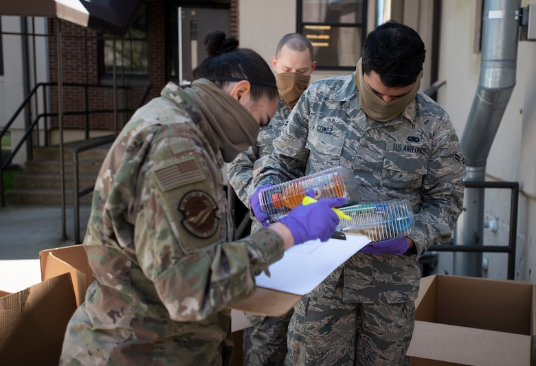 U.S. Air Force Staff Sgt. Karissa Kayfes, 87th Logistics Readiness Squadron NCO in charge of unit training, and U.S. Air Force Airman 1st Class Hector Gomez, 87th LRS fuels distributor, process inventory of meals before distributing them to quarantined personnel at Camp JBMDL on Joint Base McGuire-Dix-Lakehurst, N.J., May 5, 2020. Service members around the installation provide additional support to the 87th Force Support Squadron to ensure each individual gets a meal on time. (U.S. Air Force photo by Senior Airman Ariel Owings)