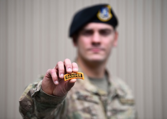 U.S. Air Force Staff Sgt. Joseph Pace, 92nd Security Forces Squadron installation patrolman, holds his Ranger tab at Fairchild Air Force Base, Washington, May 7, 2020. Pace completed the grueling 62 day course in April after starting in November 2019. (U.S. Air Force phot by Senior Airman Lawrence Sena)