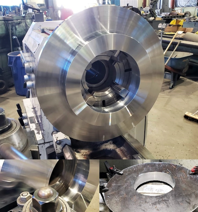 Large shiny metal circle on a complex machine