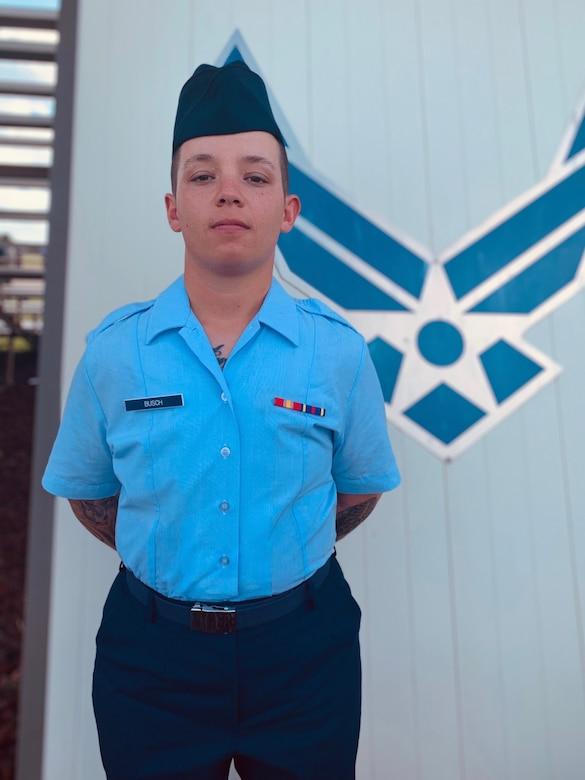 Airman Shannon Busch stands holding an award. (Courtesy Photo)