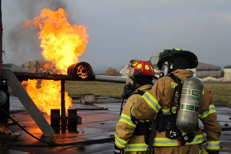 U.S. Air Force Staff Sgt. Adrianna Hopkins, 312th Training Squadron instructor, Goodfellow Air Force Base, Texas, and Senior Airman Christian Hibner, 7th Civil Engineer Squadron firefighter, Dyess AFB, Texas, participate in a burn exercise at Spangdahlem AB, Germany, October, 2018. The 52nd FES Airmen stay mission ready through the COVID-19 pandemic with consistent training to maintain their ability to respond to an emergency at a moment's notice. (Photo courtesy of Senior Airman Sean Howley)
