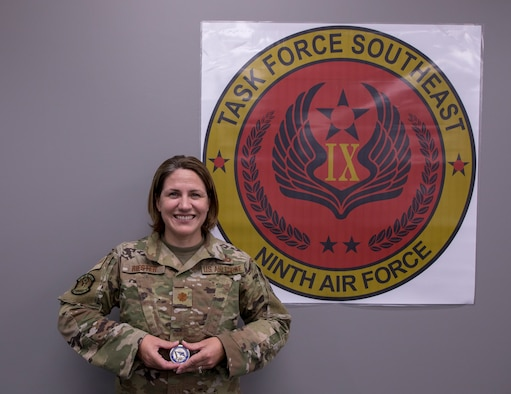 Major Melissa Reister in photograph holding CSAF coin.