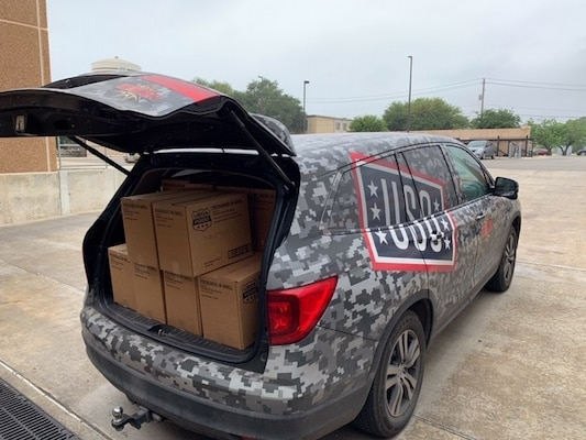 A United Service Organizations San Antonio is parked while making deliveries to Joint Base San Antonio-Fort Sam Houston and Lackland Air Force Base, Texas, April 17, 2020. This week deliveries have occurred daily to those in quarantine, those continuing the training pipeline while observing social distancing regulations, and the ERPSS (En Route Patient Staging System Team) for the Wounded Warriors. This week's deliveries served over 18,000 with grab and go snacks, meal to go boxes, hygiene products, and other essential items.