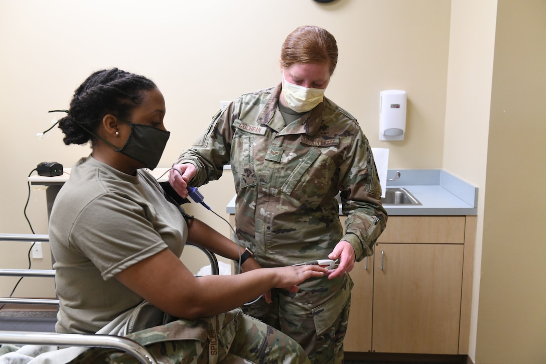 U.S. Airforce Senior Airman Lillian Cochran, a medical technician with the 145th Airlift Wing, practices taking blood pressure while conducting drills prior to accepting live patients, at the North Carolina National Guard Medical Support Shelter (MSS), Central North Carolina, April 29, 2020. The MSS is intended to act as an overflow shelter for hospital patients not infected with the COVID-19 virus and is maned by a joint task force of Army and Airforce National Guard medical staff.