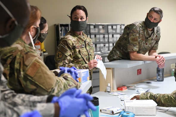 Medical technicians with the North Carolina Army and Air National Guard prepare to practice sticking IV needles in order to prepare for the possible arrival  of potential patients, while at the North Carolina National Guard Medical Support Shelter (MSS), Central North Carolina, April 30, 2020. The MSS is intended to act as an overflow shelter for hospital patients not infected with the COVID-19 virus and is maned by a joint task force of Army and Airforce National Guard medical staff.