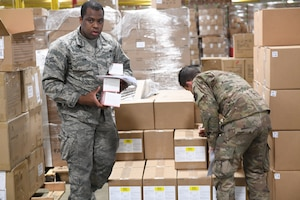 Photo of 145th Logistics Readiness Airmen supporting a local North Carolina Supply Warehouse delivering medical supplies to medical centers dealing with COVID-19.