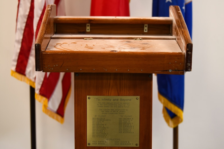 A time capsule is displayed during a virtual Airman Leadership School graduation at Aviano Air Base, Italy, May 15, 2020. The capsule was constructed by the class of 99-A Aviano Airman Leadership School and it was requested to be opened by the first leadership school class of the United States Air and Space Force. (U.S. Air Force photo by Airman 1st Class Ericka A. Woolever)