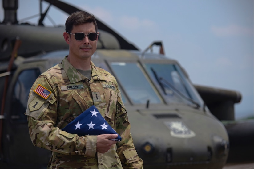 Chief Warrant Officer 4 Joval Eblen III, 1st Battalion, 228th Aviation Regiment pilot, stands in front of one of his unit's UH-60 Blackhawk helicopters with his personal American flag at Soto Cano Air Base, Honduras May 14, 2020.