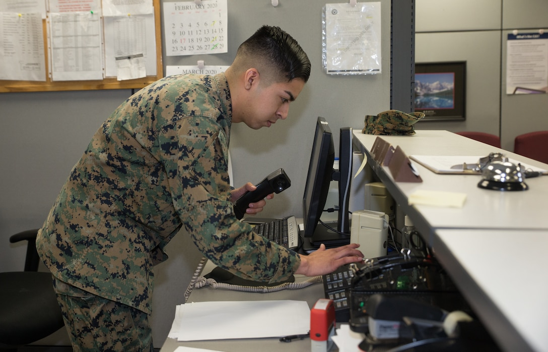 A U.S. Marine assists a customer at Marine Corps Air Station Cherry Point, North Carolina, Feb. 24.