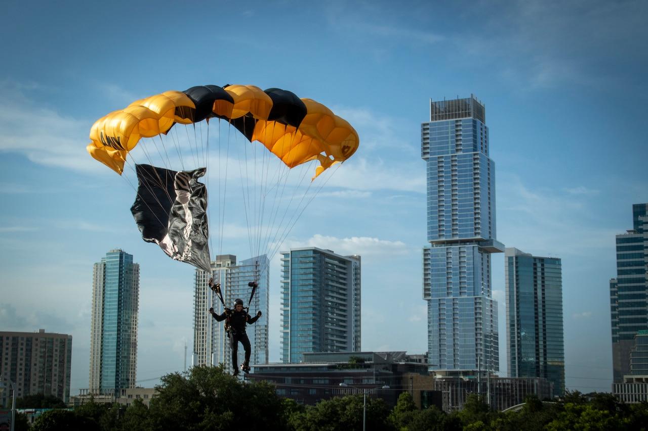 A parachutist lands in a field in Austin, Texas.