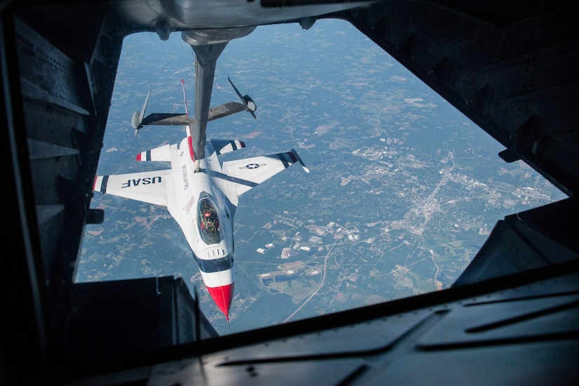 A jet is refueled in midair.