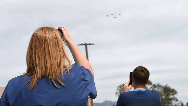 A photo of first responders recording a flyover.