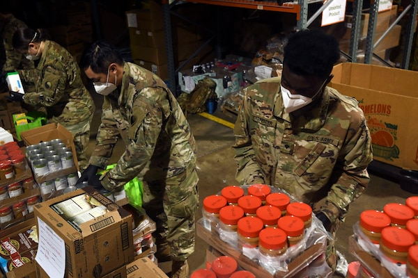 Spc. Tyree Carpenter, a combat engineer with the Virginia Army National Guard's D Company, 229th Brigade Engineer Battalion, packages food for distribution as part of his unit's COVID-19 response effort in Fredericksburg, Virginia, May 1, 2020. Carpenter and about 30 other Soldiers with 229th BEB were augmenting civilian personnel at an area food bank.